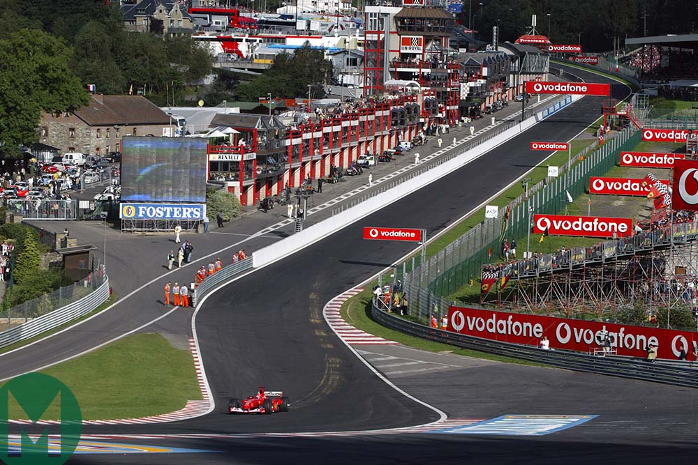 Michael Schumacher on his own as he drives through Eau Rouge at the 2002 Belgian Grand Prix