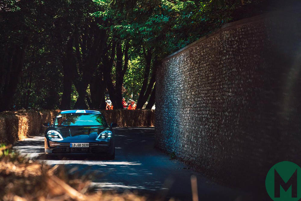 The electric Porsche Taycan races up the hill at the 2019 Goodwood Festival of Speed