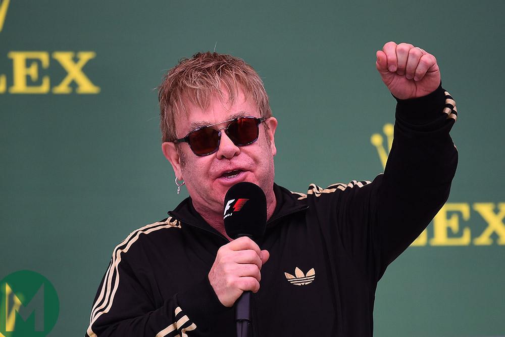 Sir Elton John on the podium at the 2015 United States Grand Prix