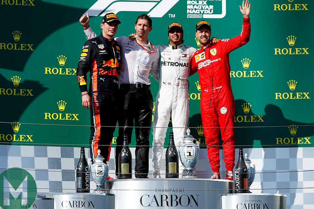 Verstappen, Mercedes' chief strategist James Vowles, Hamilton and Ferrari's Sebastian Vettel celebrate on the podium