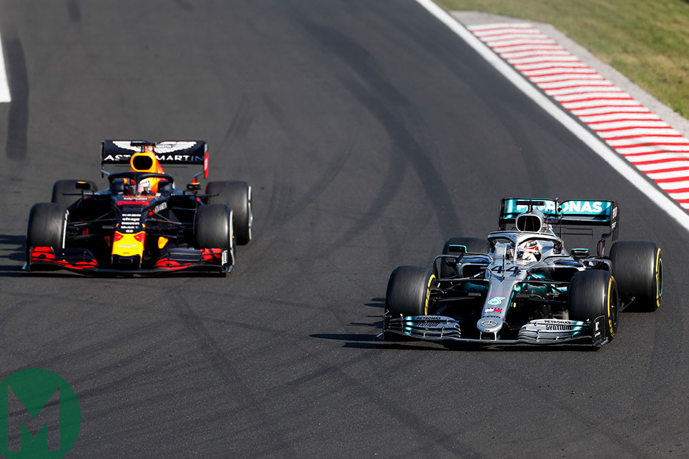 Lewis Hamilton's Mercedes gets by Max Verstappen's Red Bull late on