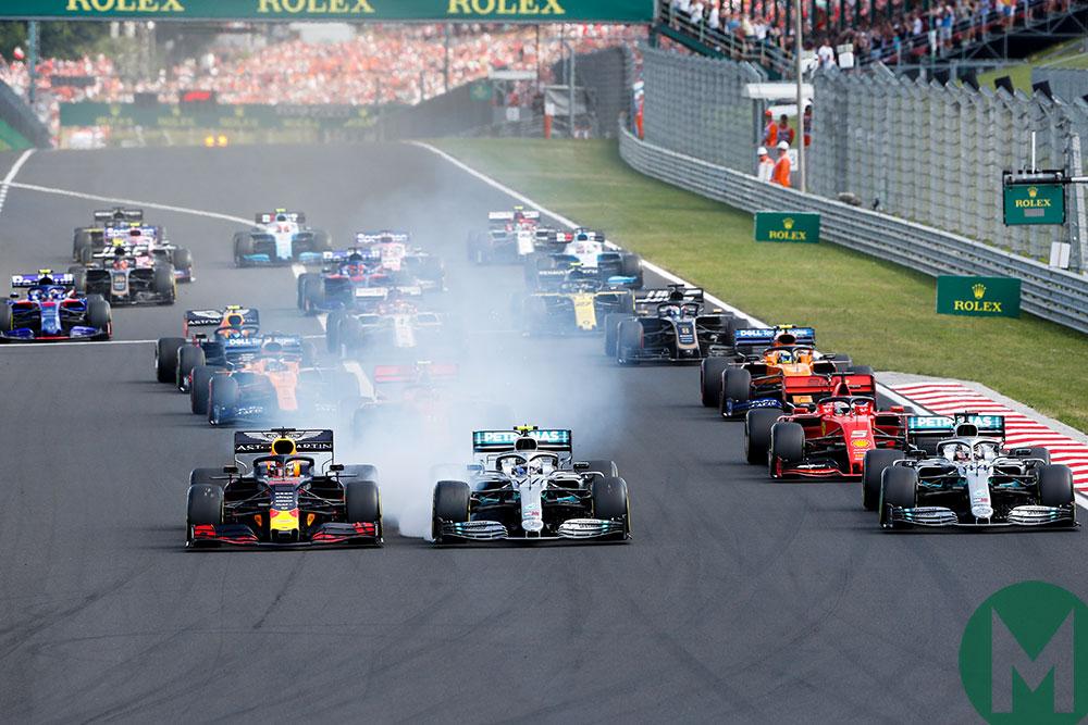 Max Verstappen's Red Bull holds onto the lead at the start while Valtteri Bottas's Mercedes lock ups