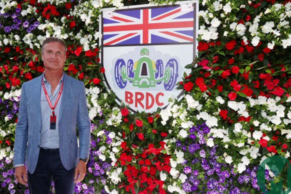 David Coulthard standing in front of a BRDC logo