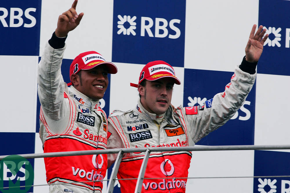 Lewis Hamilton and Fernando Alonso on the podium at the 2007 United States Grand Prix