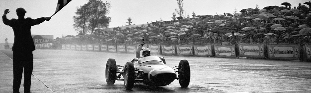 Stirling Moss crosses the line to win the 1961 German Grand Prix