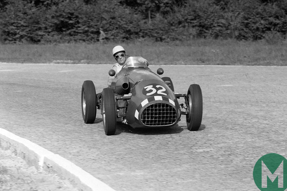 Stirling Moss leans as he takes a corner at the 1952 Italian Grand Prix