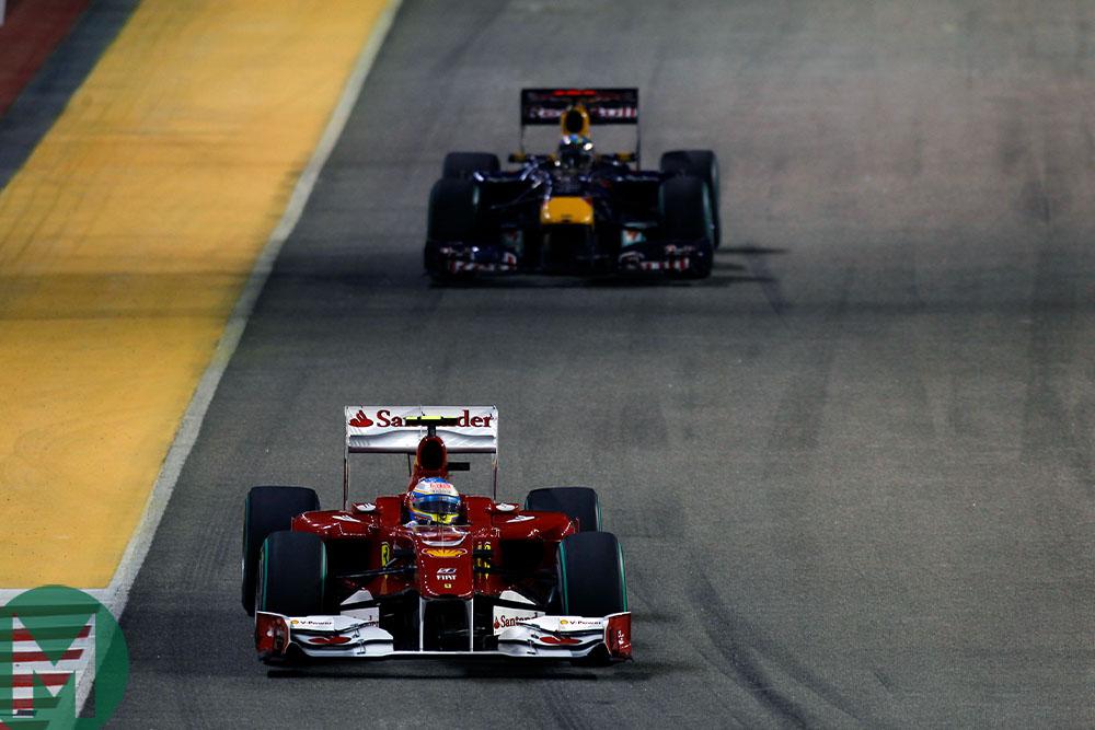 Fernando Alonso leads Sebastian Vettel during the 2010 Singapore Grand Prix