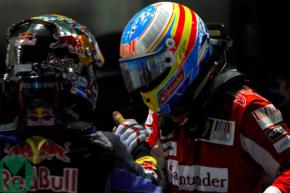 Fernando Alonso and Sebastian Vettel in parc ferme after the 2010 Singapore Grand Prix