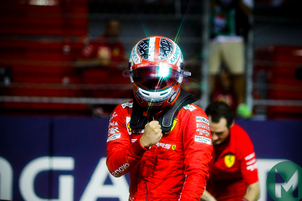 Charles Leclerc pumps his fist after securing pole position during qualifying for the 2019 f1 Singapore Grand Prix