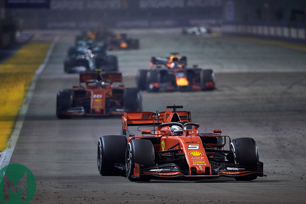 Sebastian Vettel leads the field after a safety car restart at the 2019 F1 Singapore Grand Prix