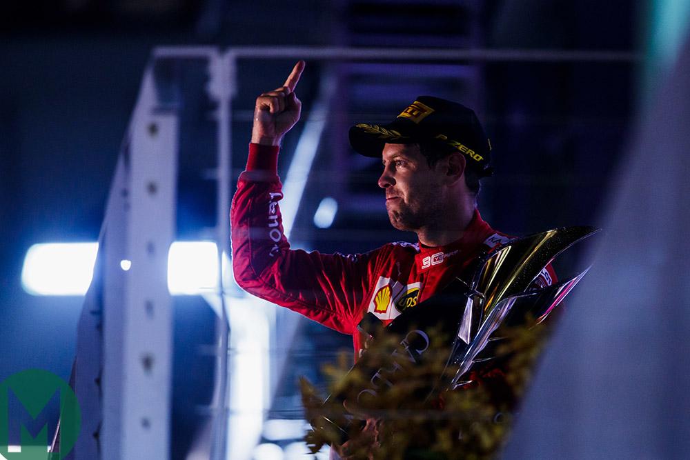 Sebastian Vettel on the podium after winning the 2019 Singapore Grand Prix
