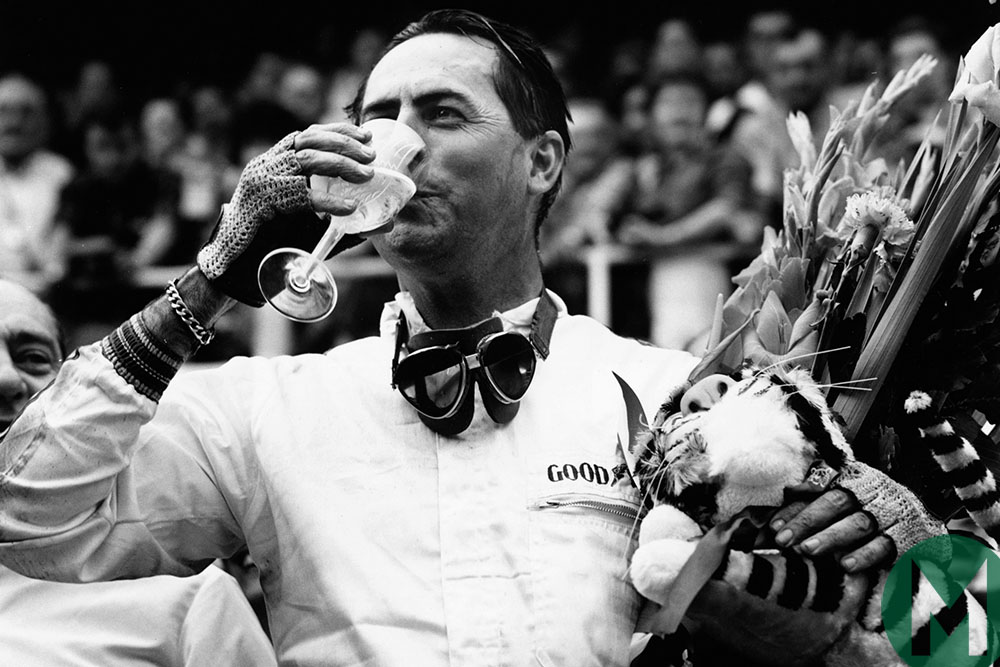 Jack Brabham drinks champagne after winning the 1966 French Grand Prix in Reims