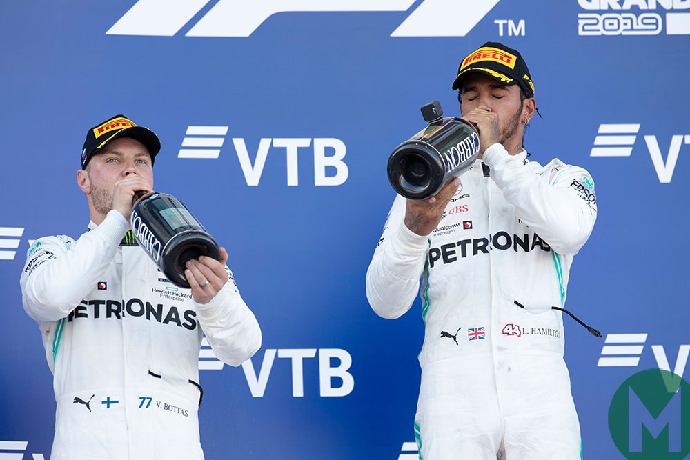 Lewis Hamilton and Valtteri Bottas drink champagne on the podium at the 2019 F1 Russian Grand Prix