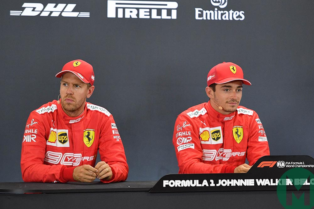 Sebastian Vettel looks away, sat next to pole-sitter Charles Leclerc at the 2019 Belgian Grand Prix