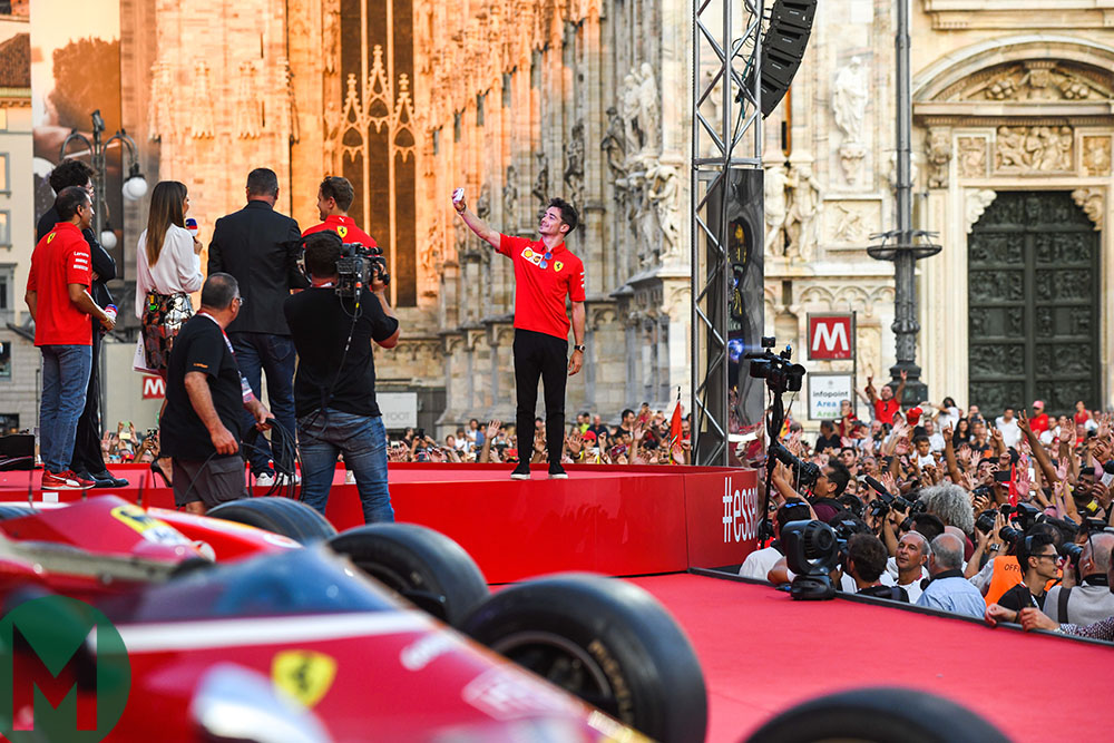 Charles Leclerc takes a selfie in front of a huge Milan crowd to celebrate Ferrari's 90th  birthday ahead of the 2019 Italian Grand Prix