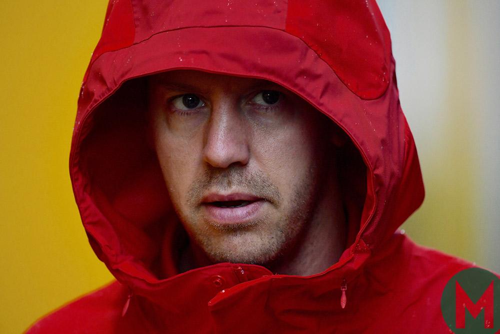 Sebastian Vettel in a hood on a rainy Friday at the 2019 Italian Grand Prix