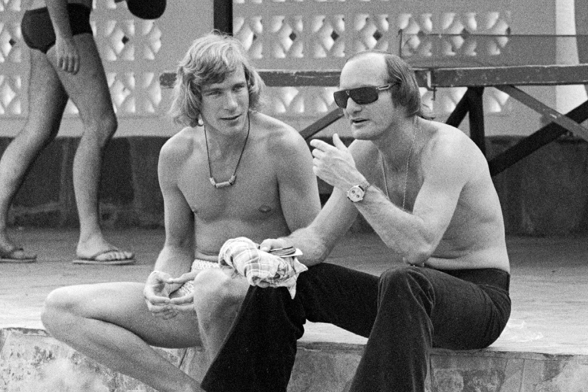 Mike Hailwood and James Hunt at the Kylami Ranch Hotel during the 1974 South African Grand Prix weekend
