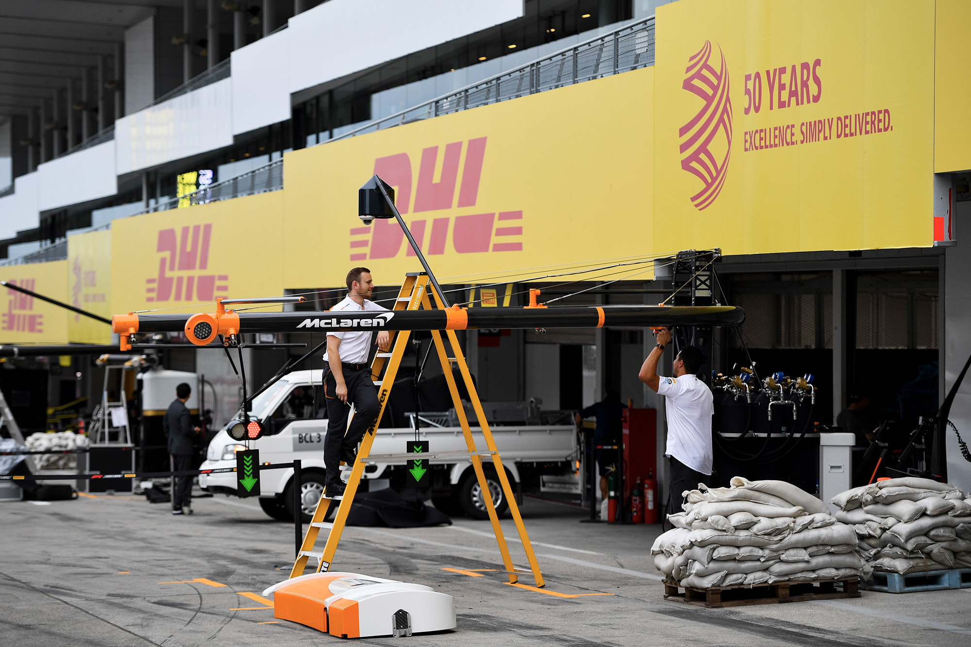 Sandbags outside the McLaren pits as qualifying for the 2019 F Japanese Grand Prix is postponed ahead of the arrival of a typhoon