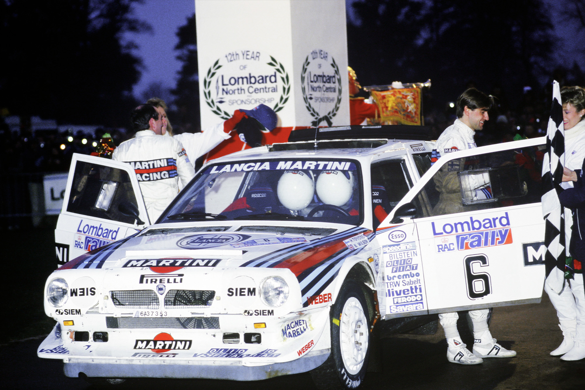 Henri Toivonen and co-driver Neil Wilson celebrate victory in the 1985 RAC Rally