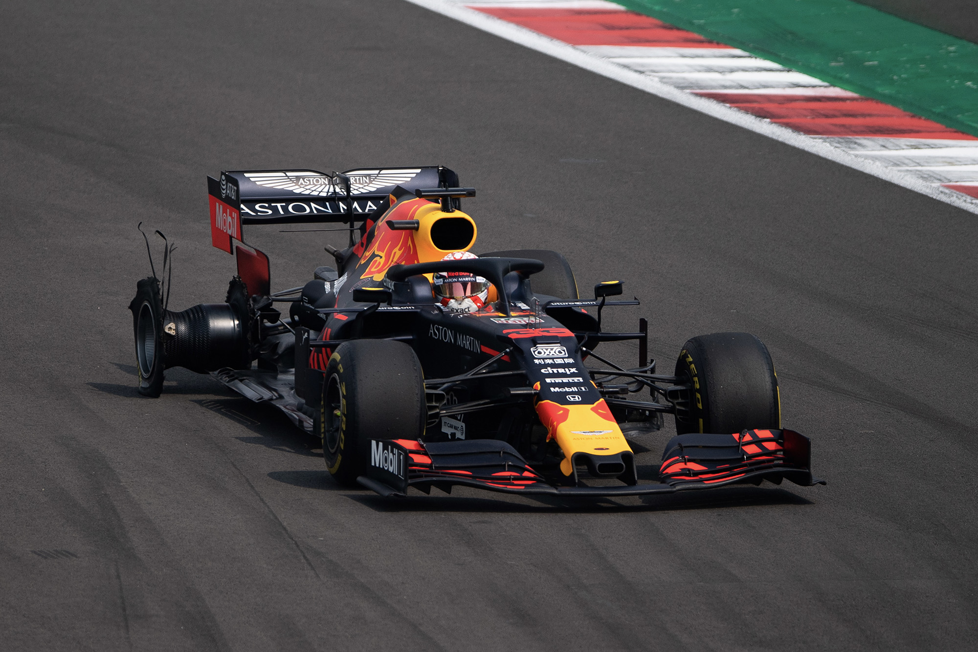 Max Verstappen's Red bull with destroyed right rear tyre after a puncture at the 2019 F1 Mexican Grand Prix