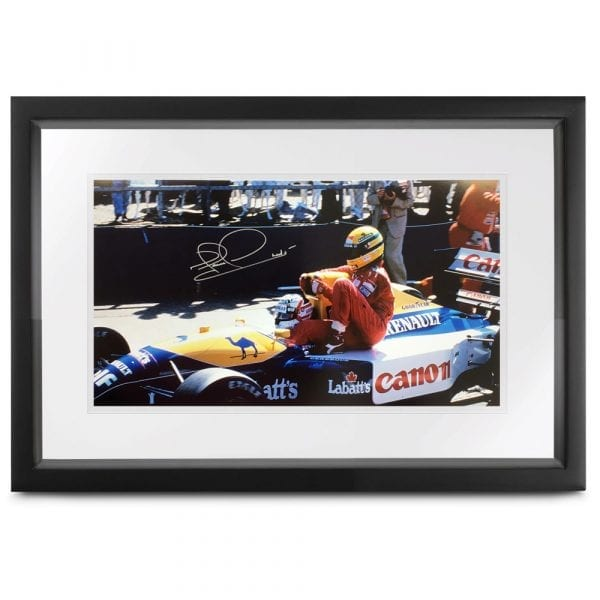 Signed photograph of Nigel Mansell in the FW14 at the 1991 British GP