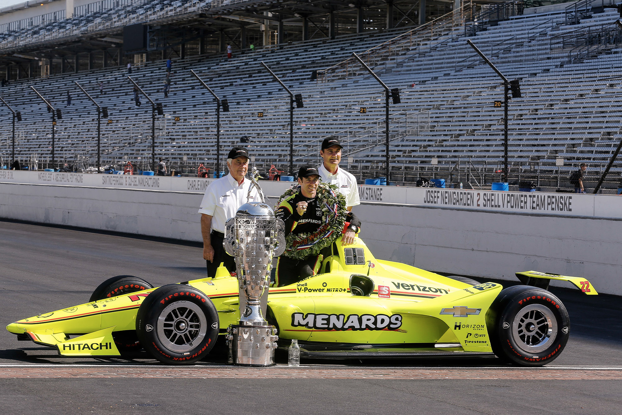 Roger Penske and Simon Pagenaud pose for the winners photos after the 2019 Indy 500