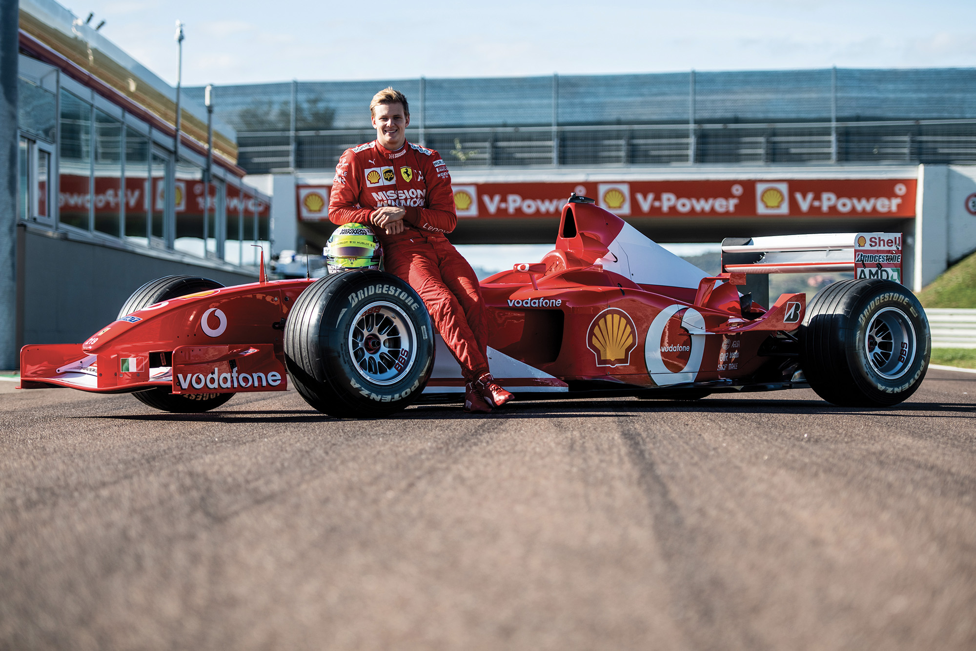 Mick Schumacher with his father's 2002 championship winning Ferrari F2002