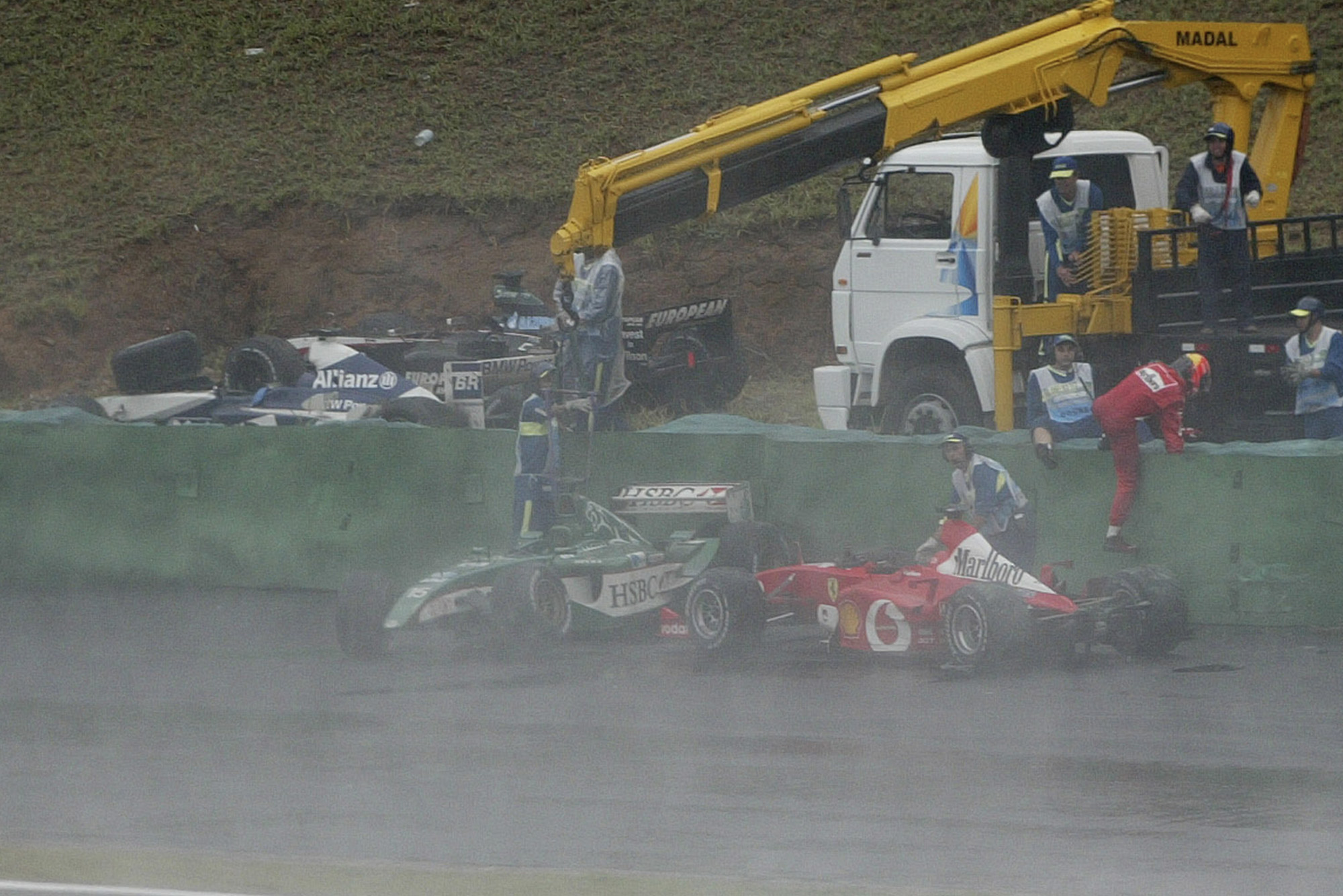 Michael Schumacher crashes out of the 2003 Brazilian Grand Prix