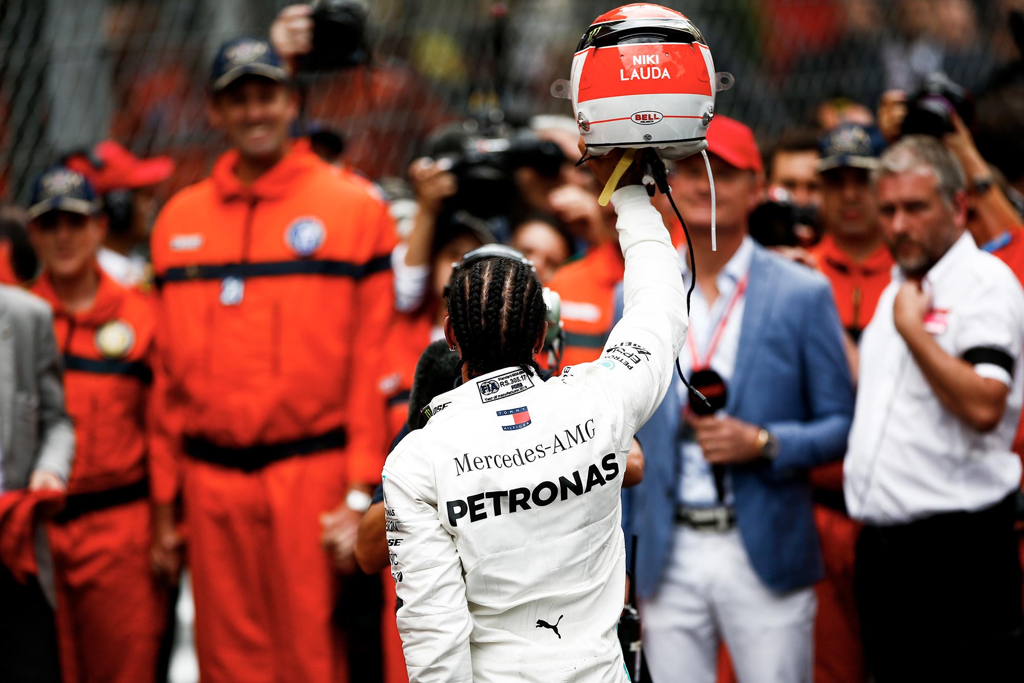 Lewis Hamilton raises his Niki Lauda tribute helmet at the 2019 Monaco Grand Prix