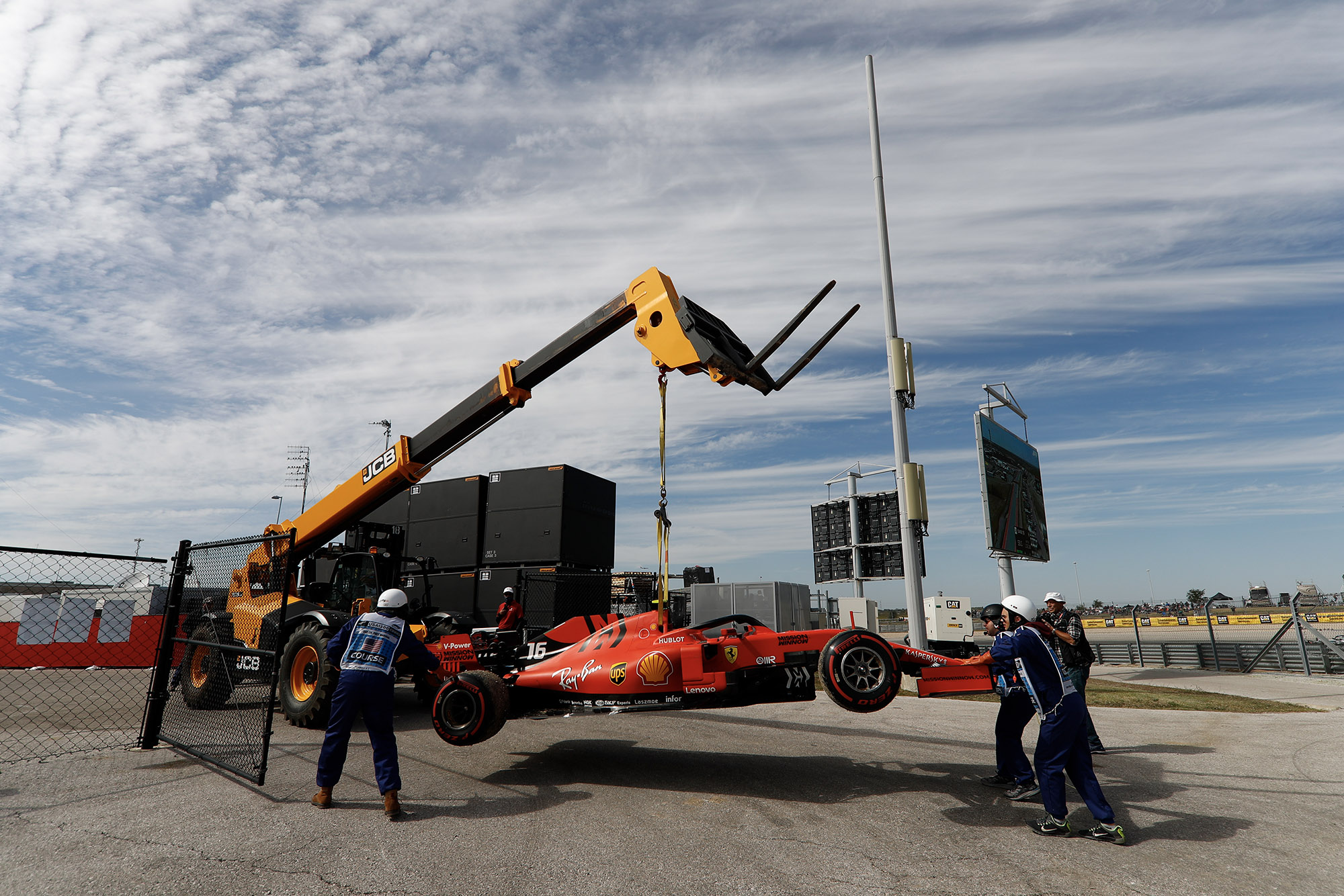 Charles Leclerc's Ferrari being lifted by a tractor in practice ahead of qualifying for the 2019 US Grand Prix