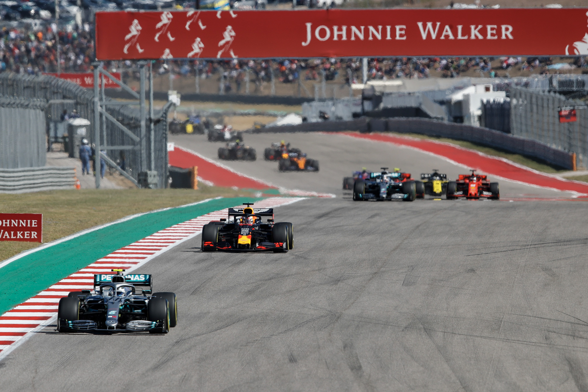 Valtteri Bottas leads from Max Verstappen and Lewis Hamilton early in the 2019 United States Grand Prix