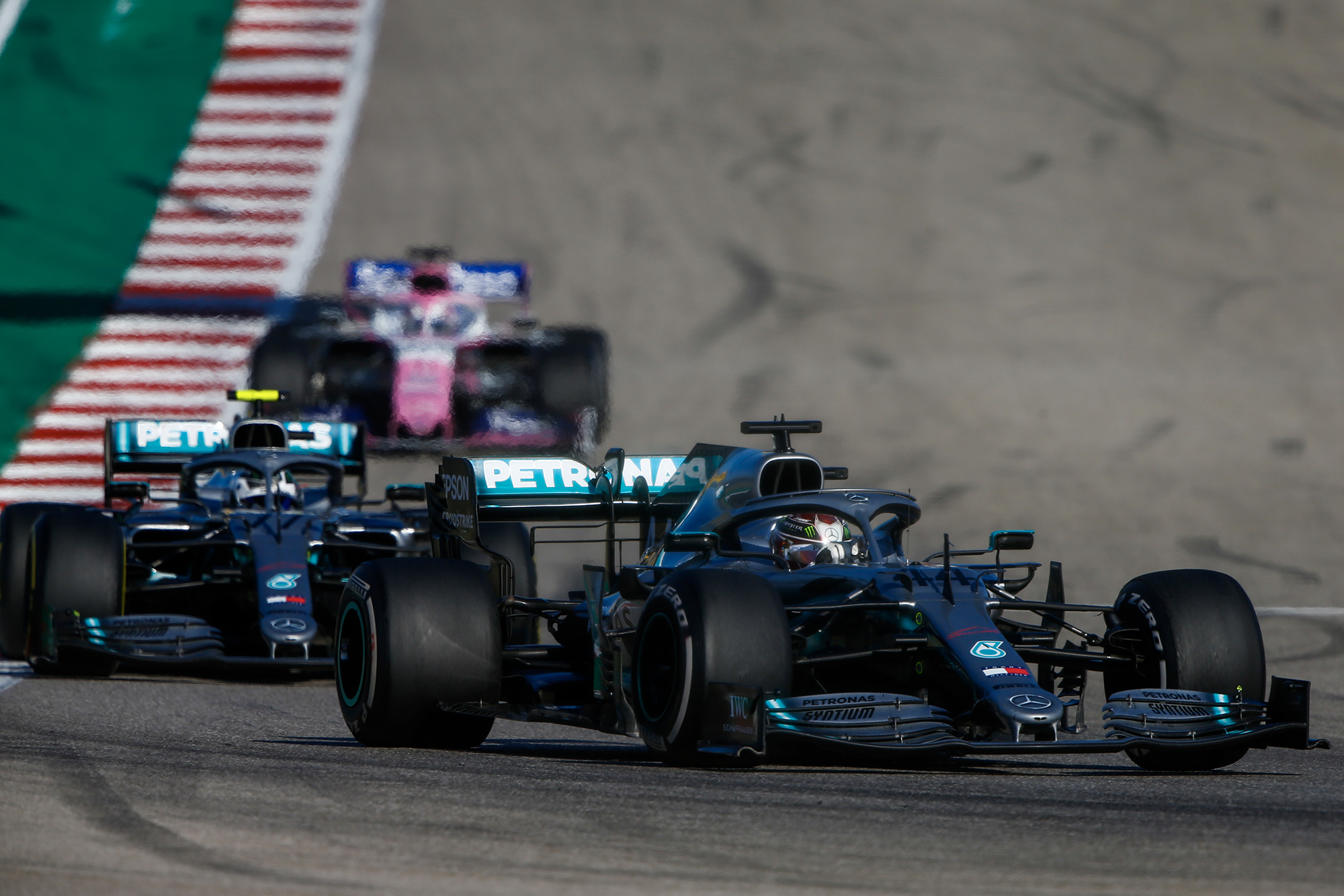 Valtteri Bottas follows closely behind Lewis Hamilton during the 2019 US Grand Prix