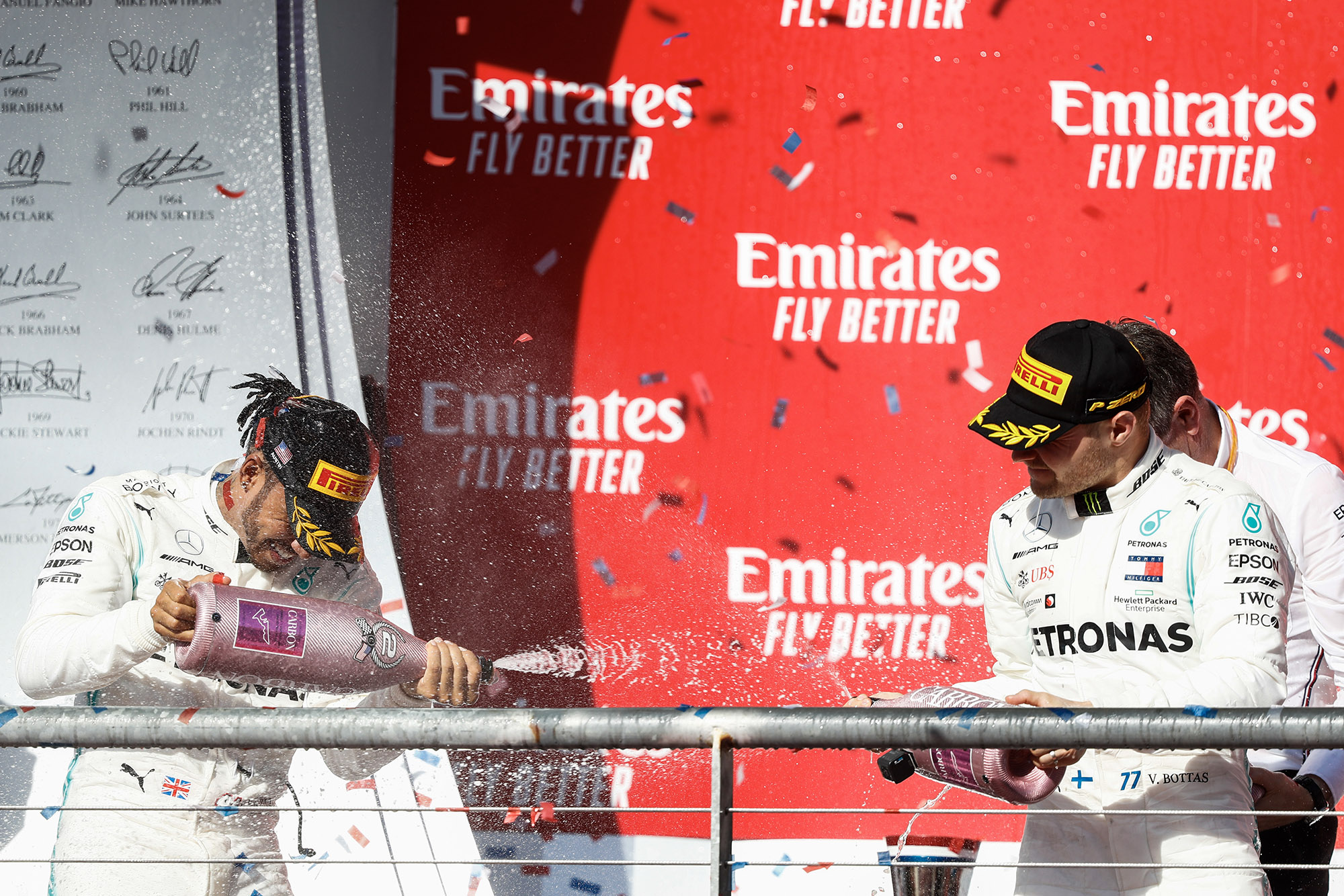 Lewis Hamilton and Valtteri Bottas spray champagne on the podium after the 2019 United States Grand Prix