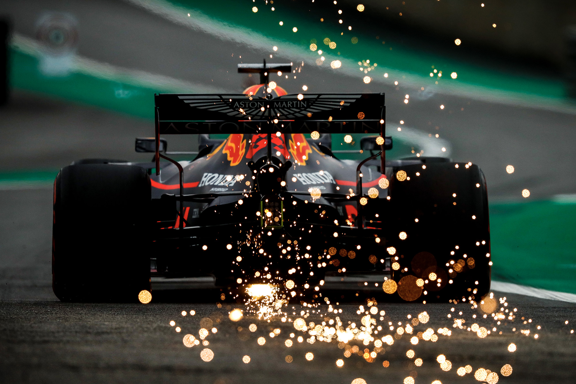 Sparks fly from the back of Max verstappen's Red Bull during qualifying for the 2019 Brazilian Grand Prix