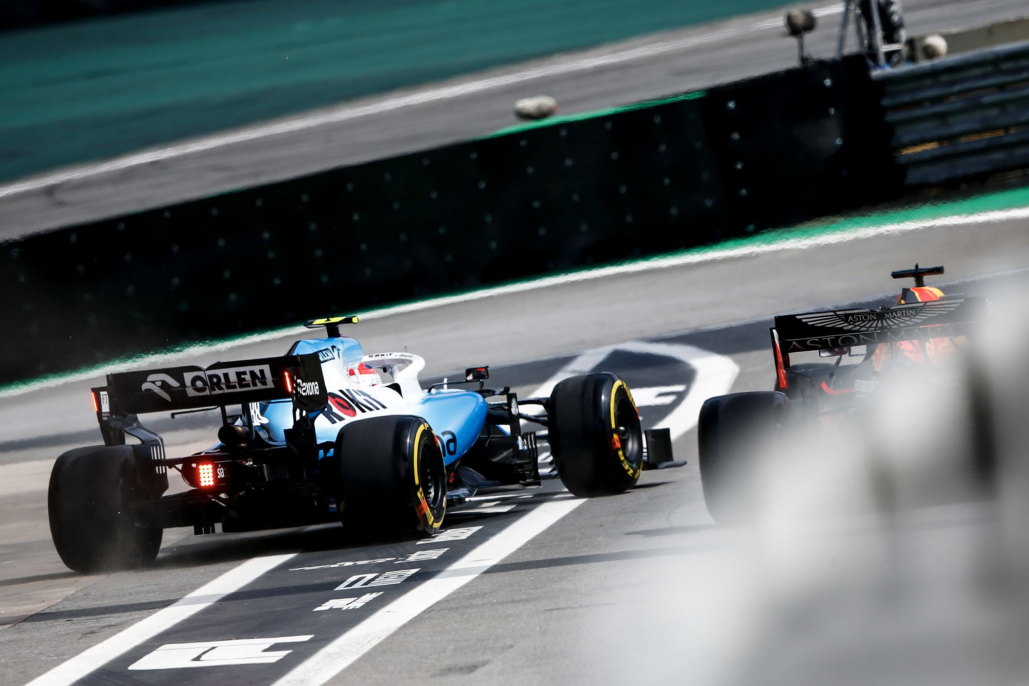 Kubica is released ahead of Verstappen in the pits during the 2019 Brazilian Grand Prix