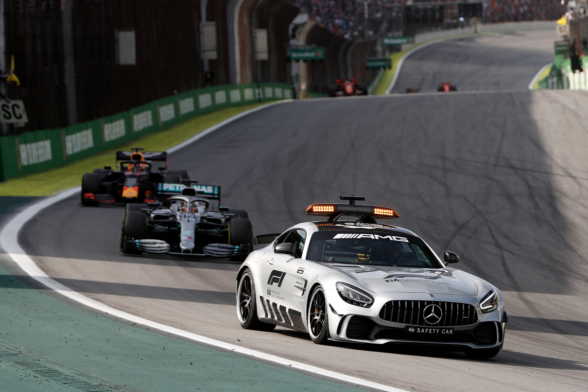 The Safety Car leads Lewis Hamilton and Max Verstappen during the 2019 Brazilian Grand Prix