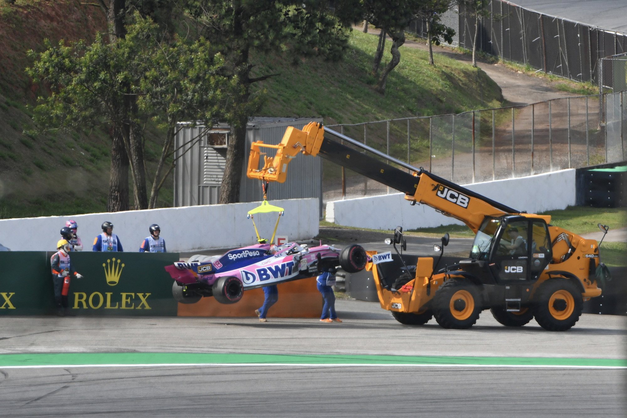 Lance Stroll's Racing Point is hoisted away by a tractor during the 2019 Brazilian Grand Prix