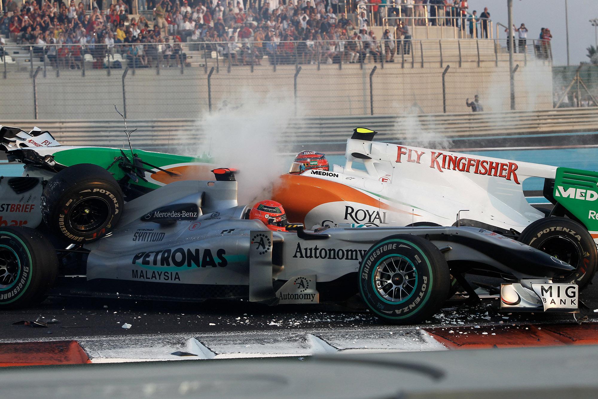 Antonio Luizzi crashes into Michael Schumacher at the start of the 2010 Abu Dhabi Grand Prix