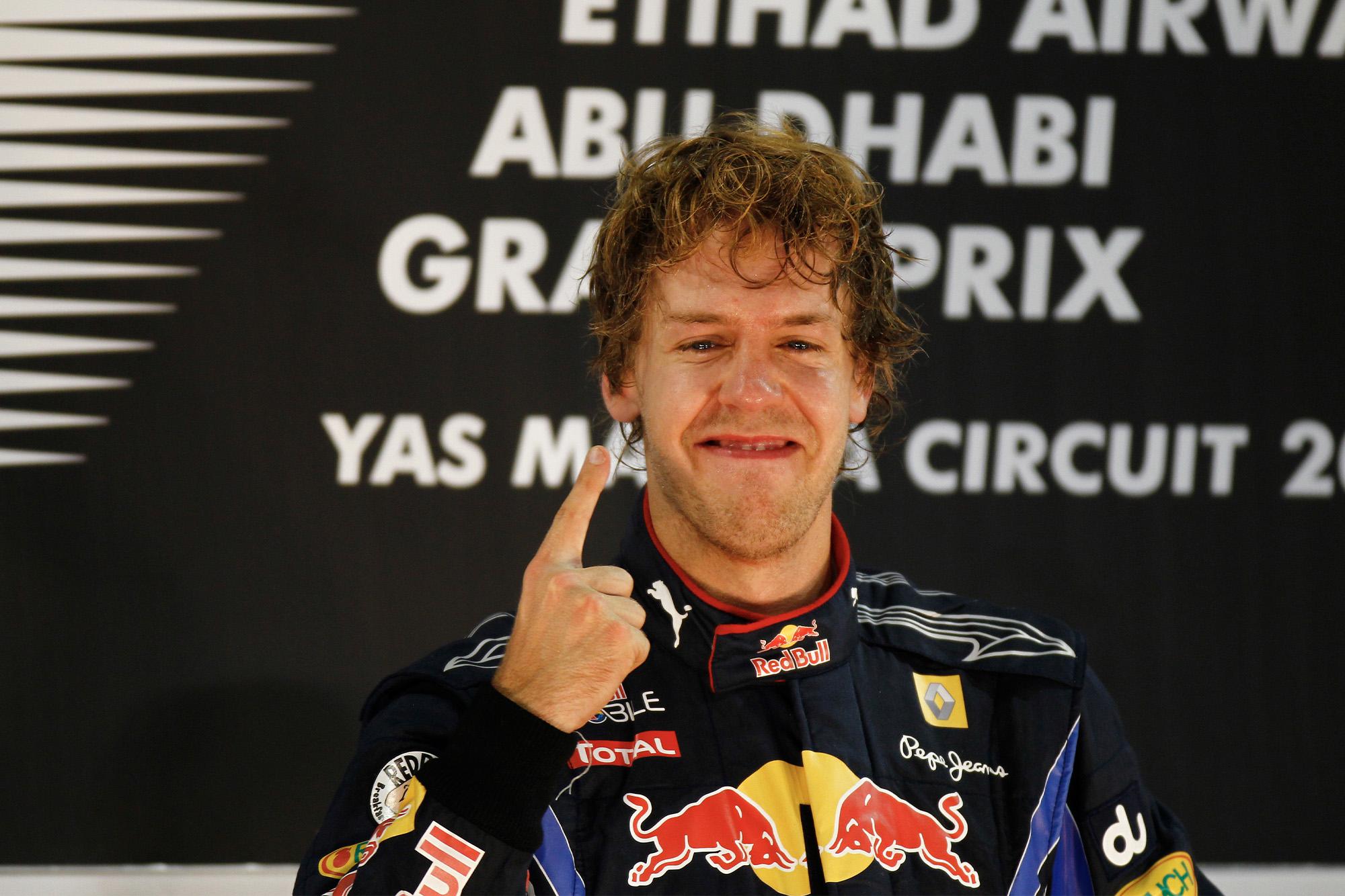 Sebastian Vettel celebrates winning the 2010 world championship and Abu Dhabi Grand Prix