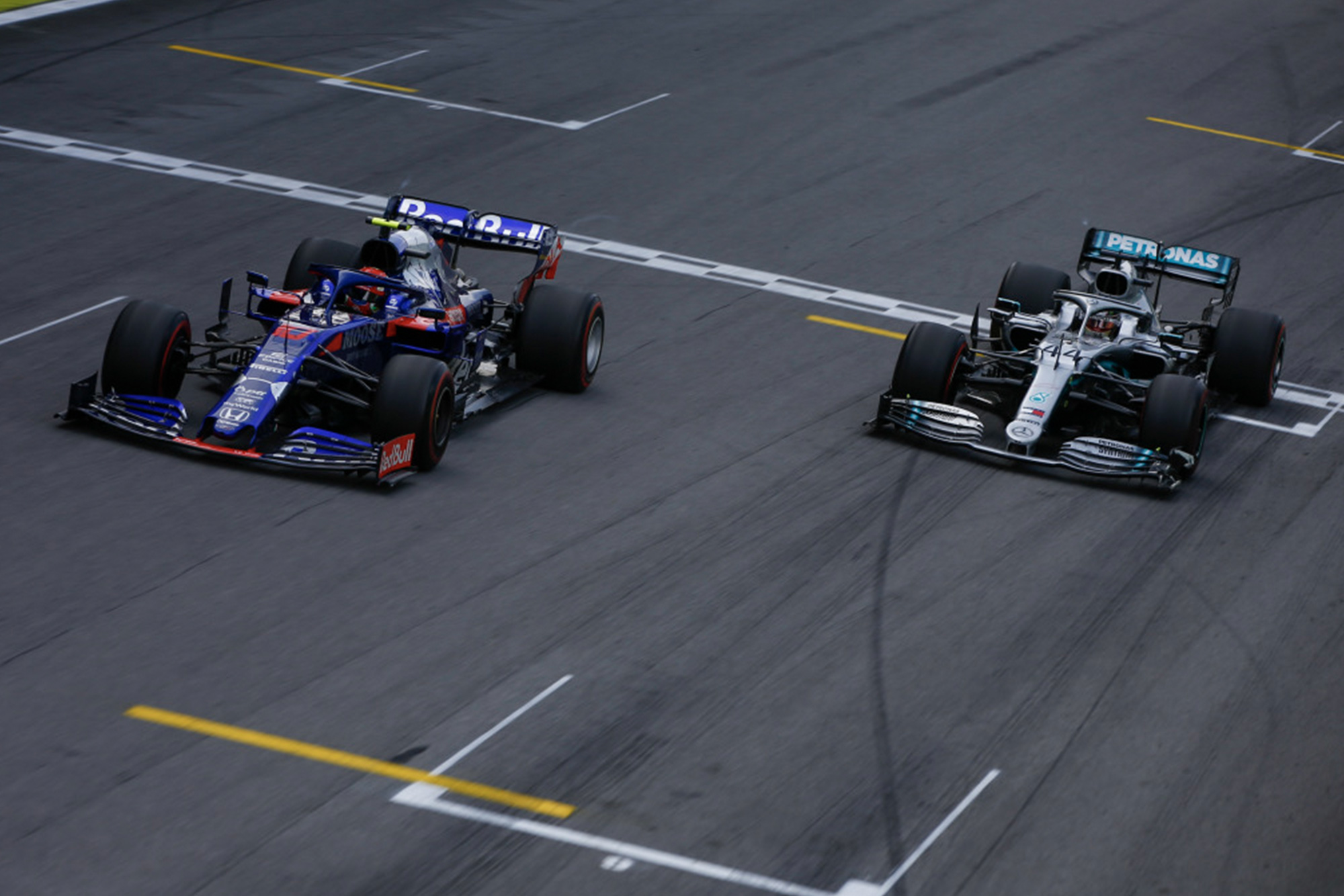 Pierre Gasly's Toro Rosso Honda out-drags Lewis Hamilton's Mercedes for second during the 2019 Brazilian Grand Prix