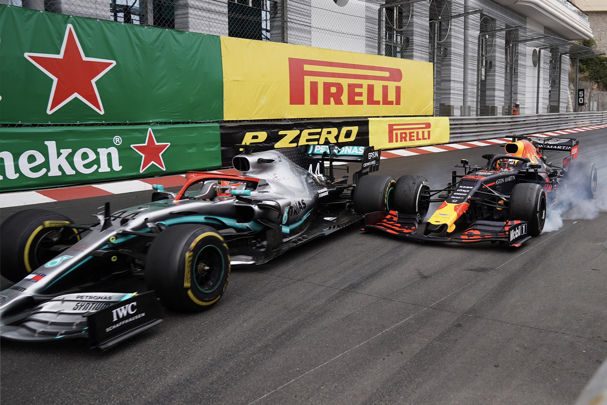 Lewis Hamilton and Max Verstappen make contact at the Nouvelle Chicane during the 2019 Monaco Grand Prix
