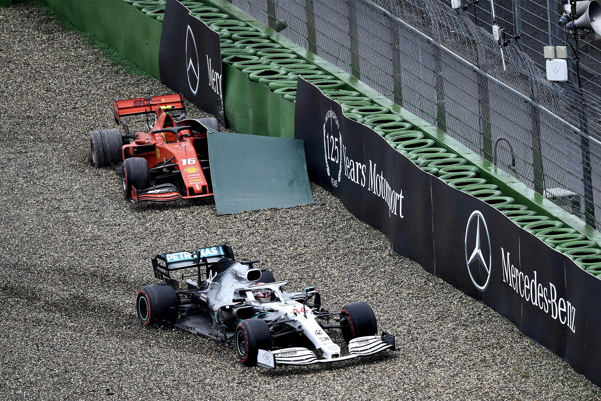 Lewis Hamilton skids past Charles Leclercs stranded Ferrari and into the barriers during the 2019 German Grand Prix