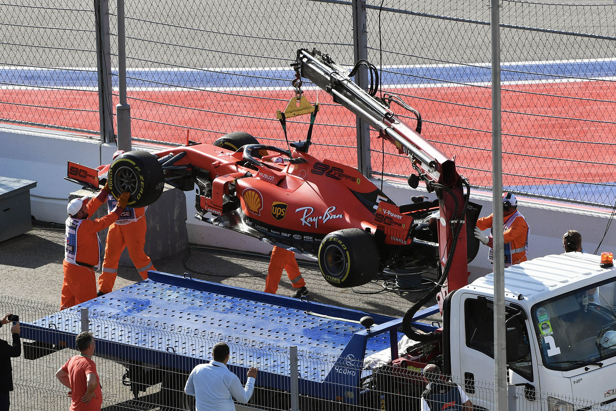 Sebastian Vettel's car is loaded onto a truck after an electrical problem forced him out of the 2019 Russian Grand Prix