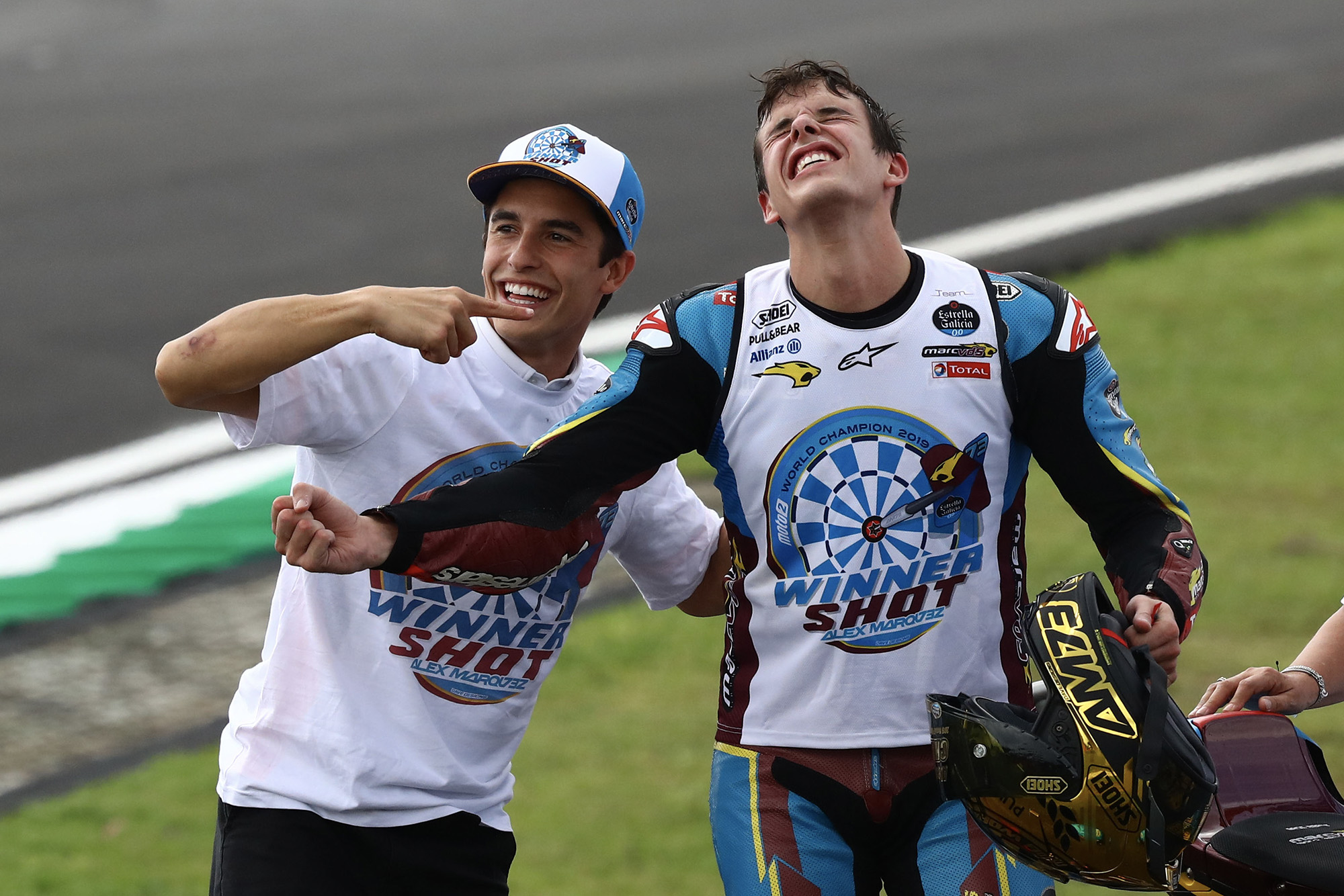 Alex Marquez celebrates winning his Moto2 title with brother Marc