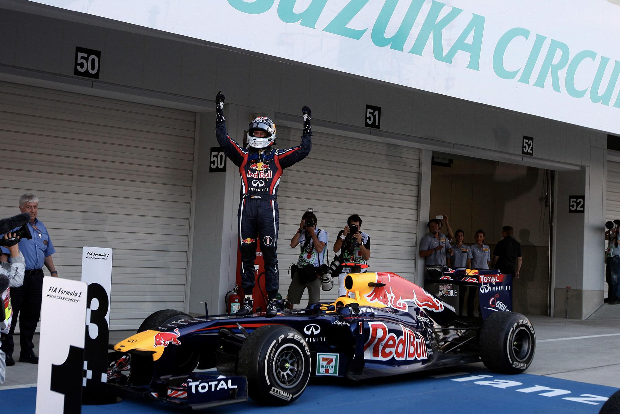 Sebastian Vettel celebrates winning the 2011 F1 championship at the Japanese Grand Prix