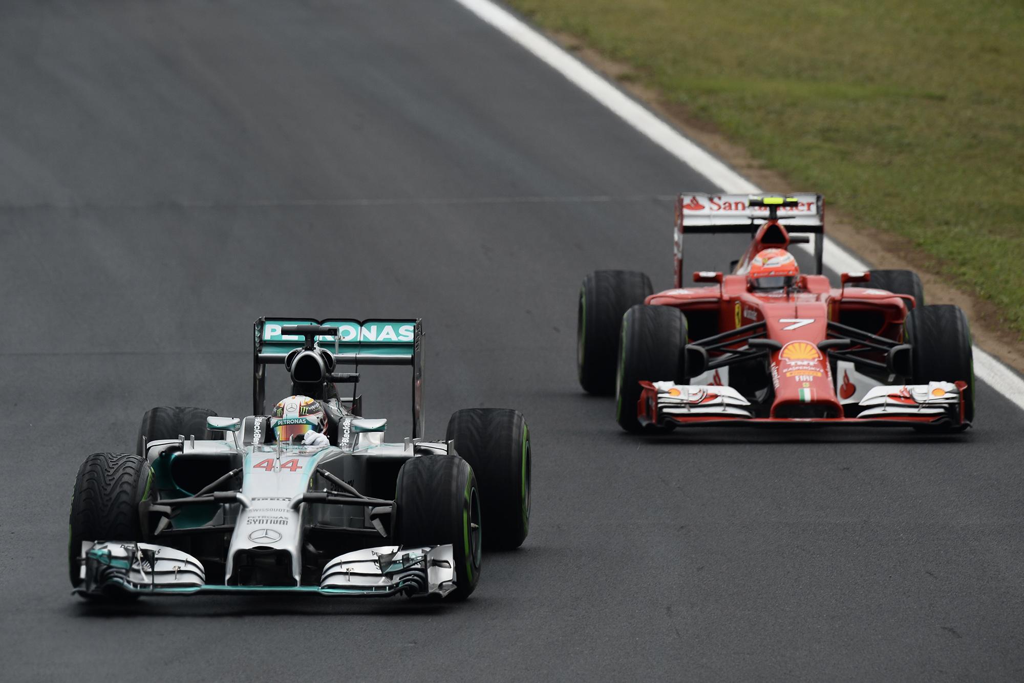 Lewis Hamilton ahead of Kimi Raikkonen's Ferrari in the 2014 F1 season