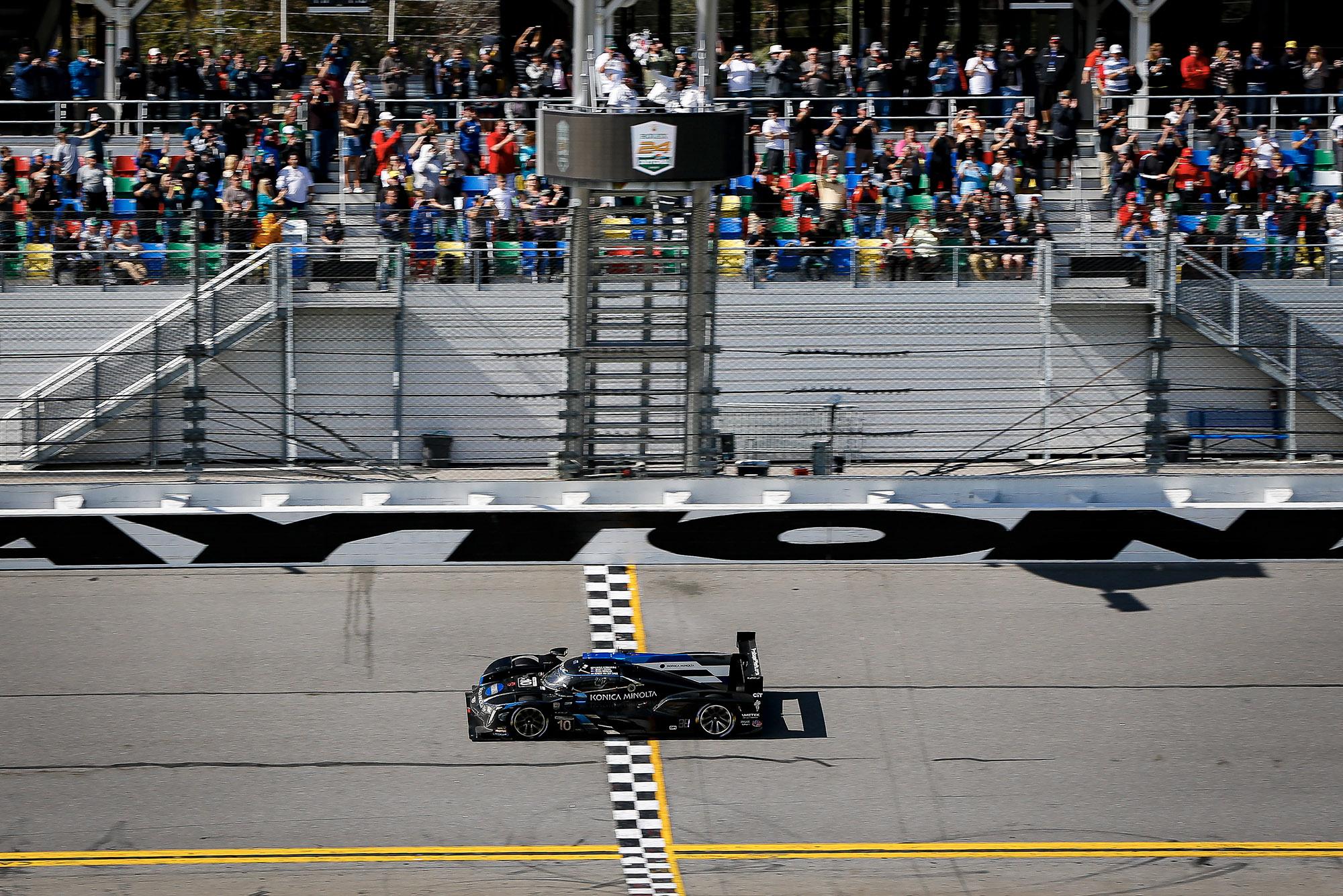 Kamui Kobayashi crosses the finish line to take victory in the 2020 Daytona 24 Hours