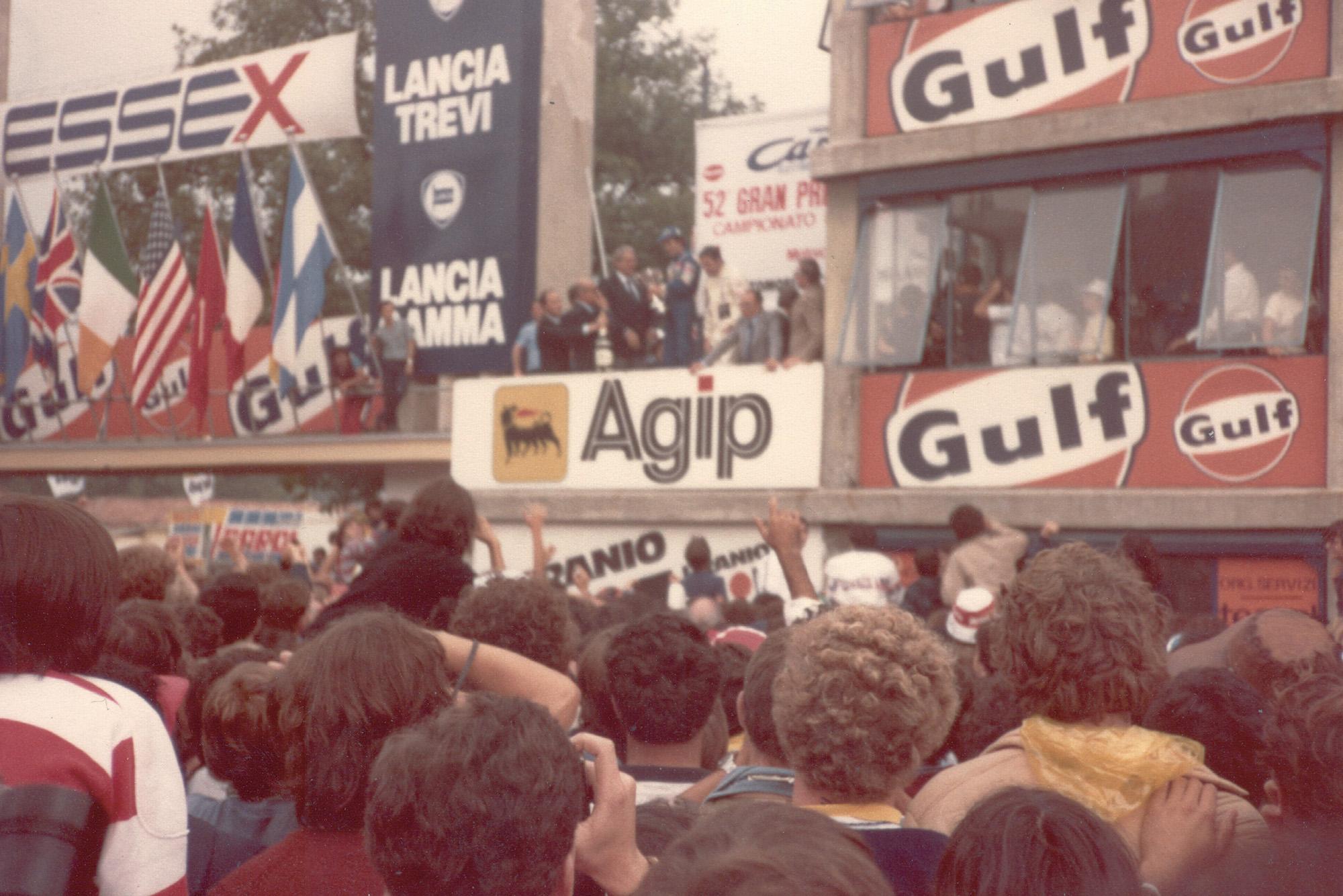 Alain Prost on the podium at the 1981 Italian GP
