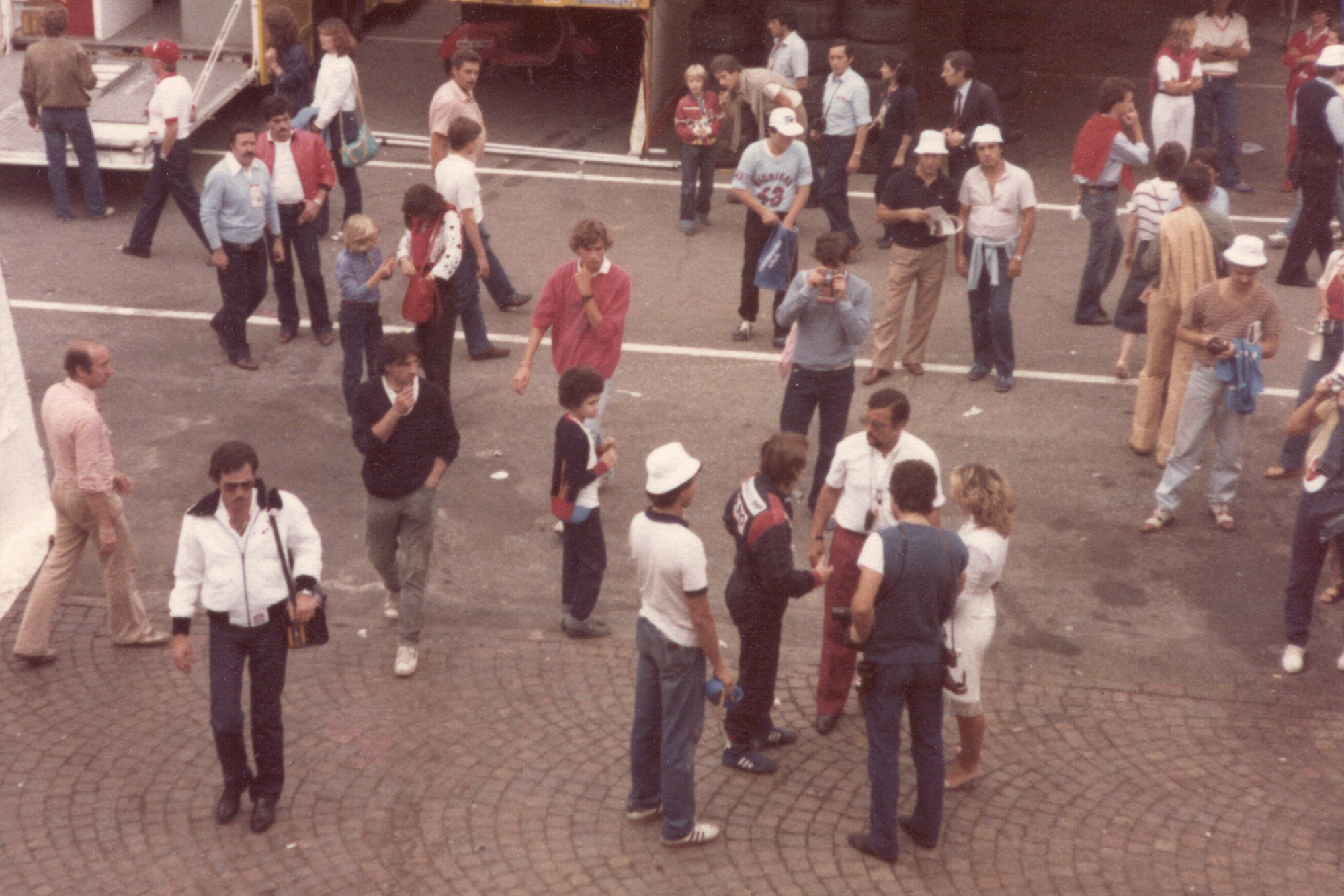 A crowd around Rene Arnoux in the paddock at the 1981 Italian Grand Prix