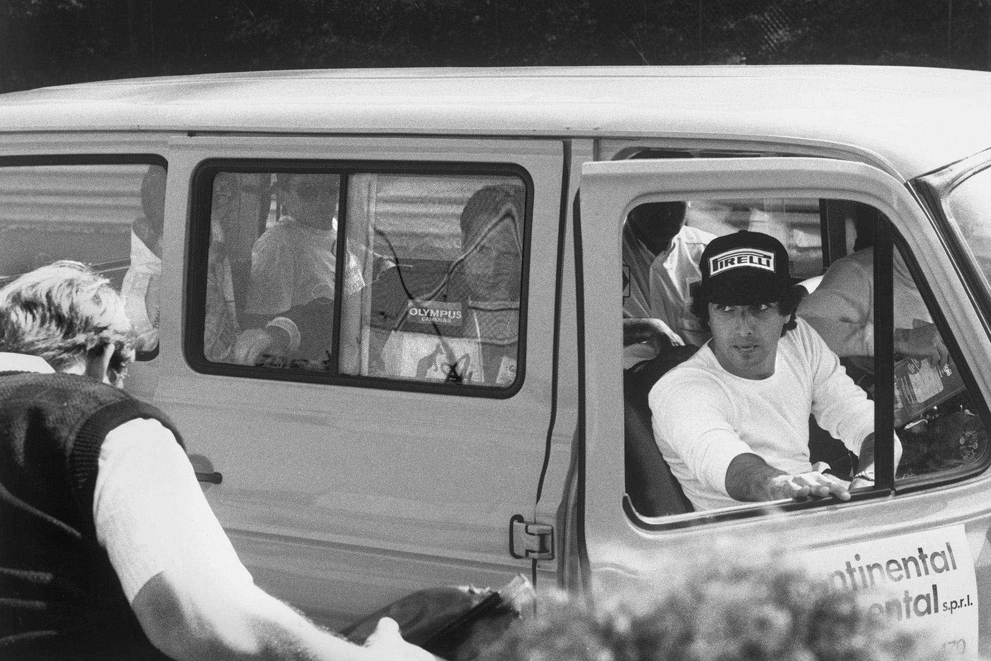 Nelson Piquet steps out of a minibus with other drivers to inspect the damage track at Spa ahead of the cancelled 1985 Belgian Grand Prix